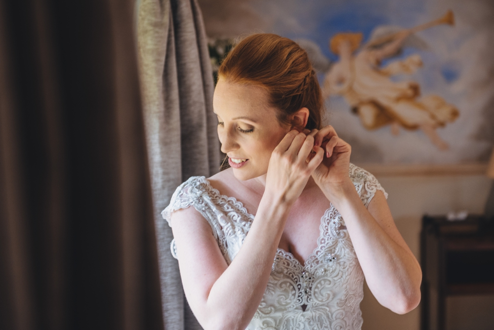 Bride_Putting_In_Earings_By_Window