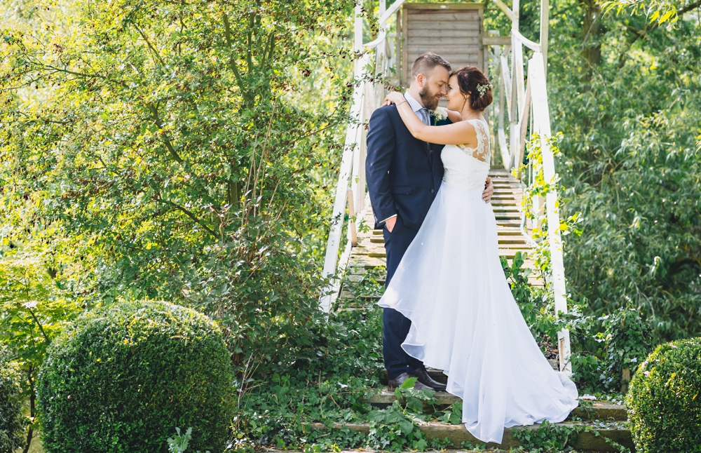 Bride_And_Groom_On_Bridge_The_River_Mill