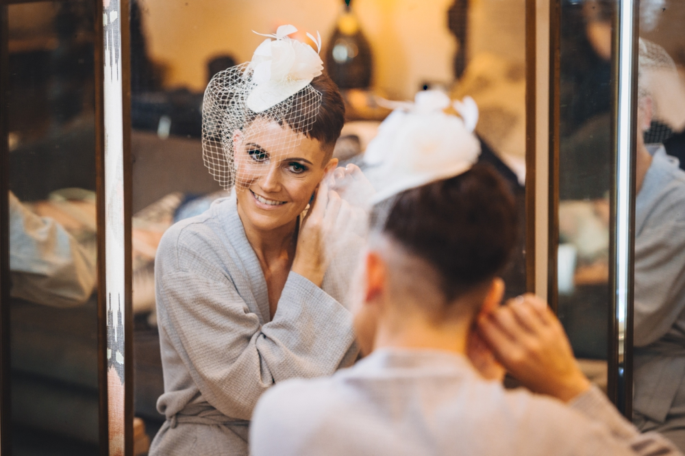 Bride adjusting earrings