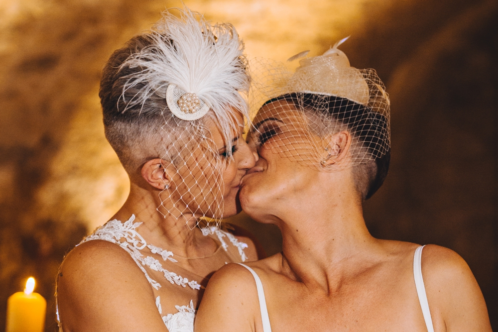 same sex couple kissing wedding day