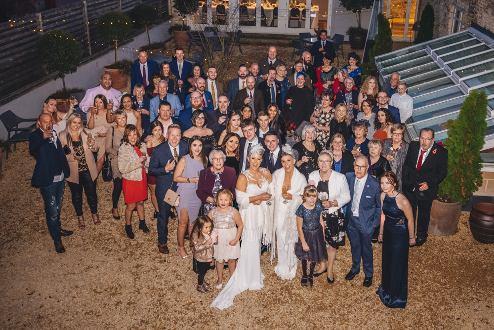 Same sex couple wedding day group formal photo