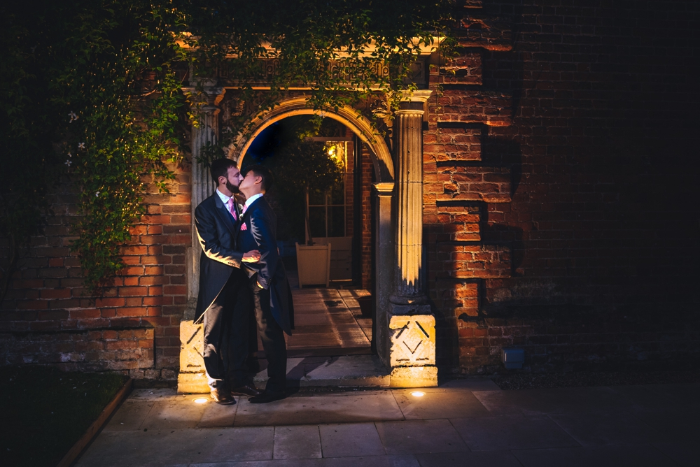 First kiss. Same sex male couple at Longstowe hall wedding venue Cambridge