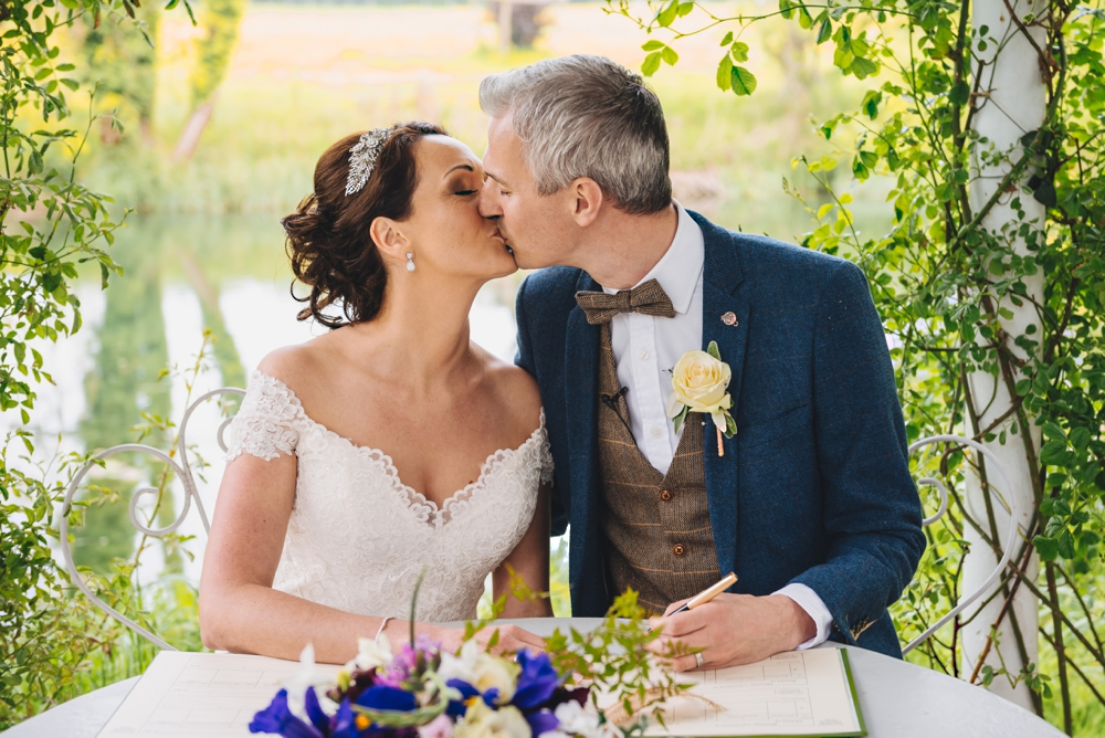 Signing the marriage register Bride and Groom Preston Court Canterbury