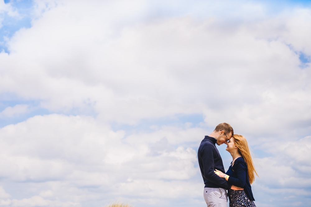 Pre wedding shot for couple on Norfolk beach against blue sky