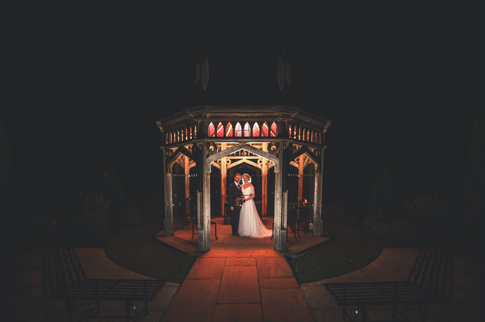 Bride and Groom night time shot at Old Hall Ely standing under pagoda