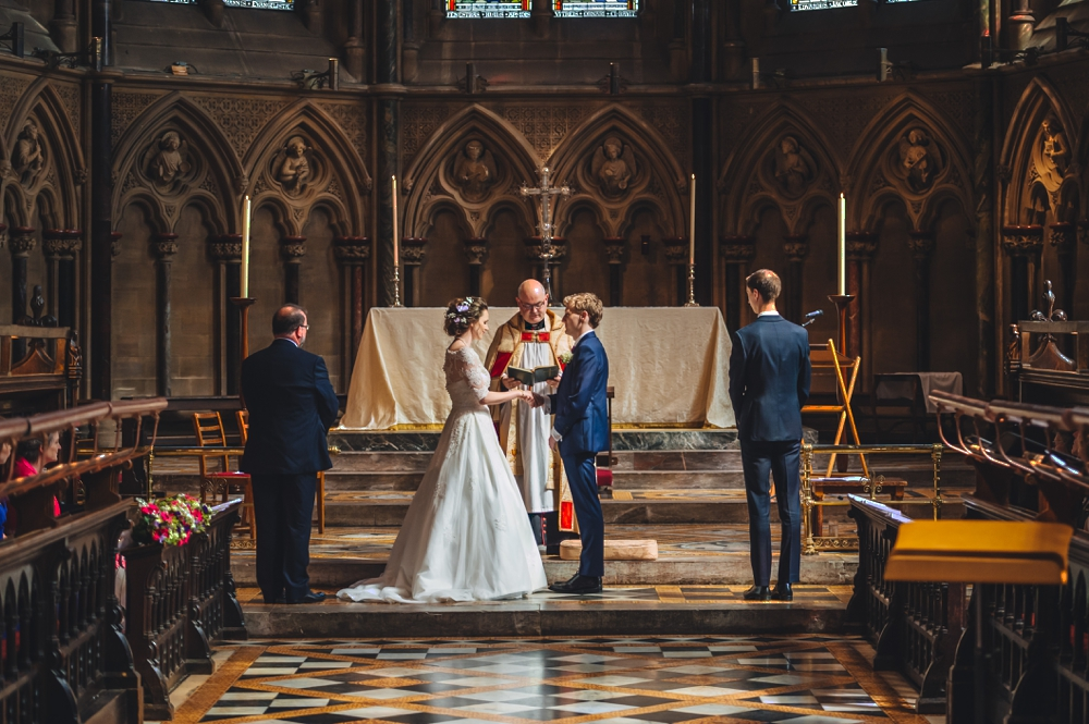 Bride and Groom at the alter St Johns College Chapel Cambridge