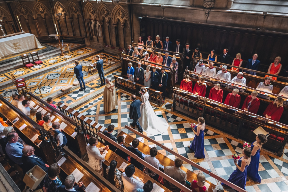 Father of the bride walking his daughter up the aisle St Johns College Chapel Cambridge