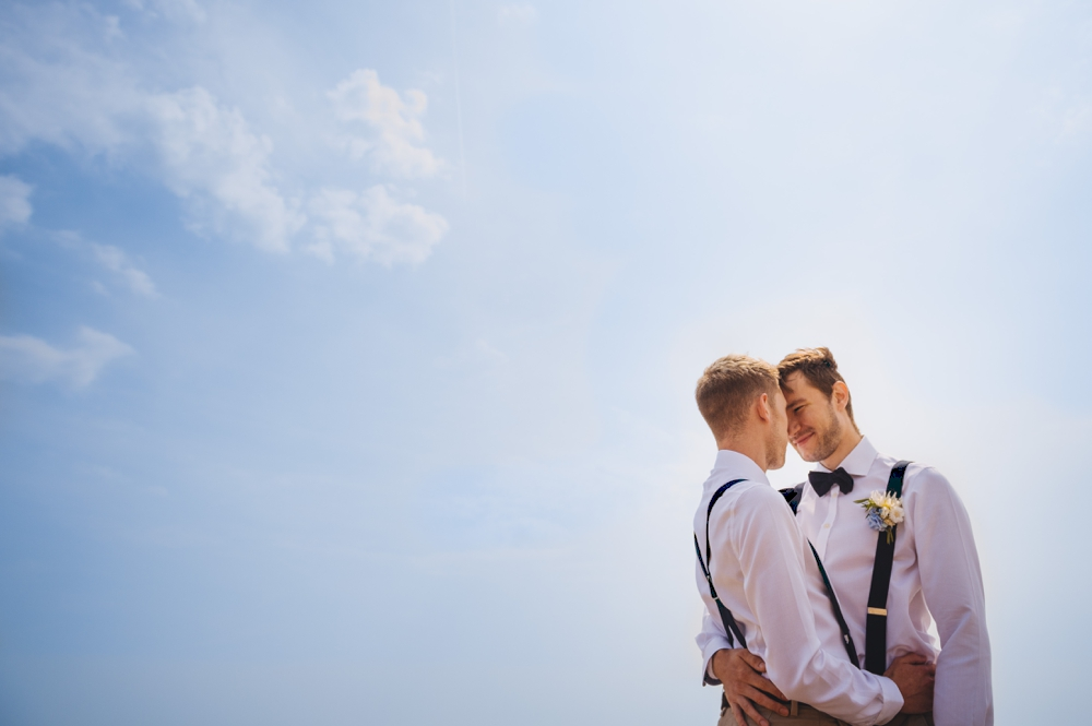 Same Sex Couple against blue sky - Pre wedding shot