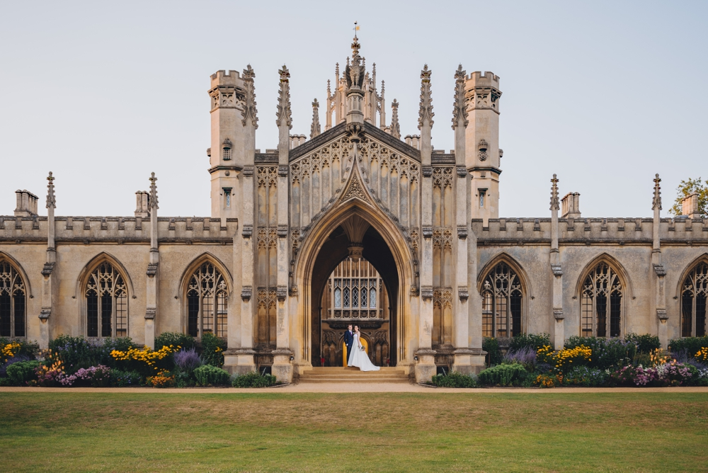 Bride and Groom standing on steps at St Johns College Cambridge