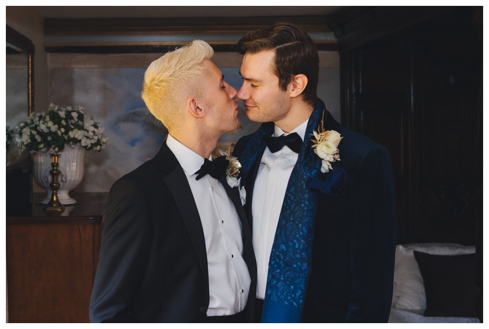Grooms wedding preparation couple kissing