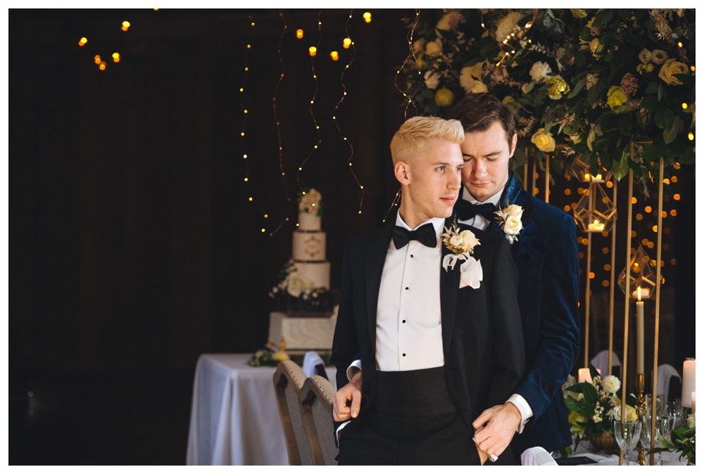 Grooms against decorated table