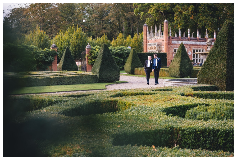 Grooms walking in the grounds of Oxnead Hall