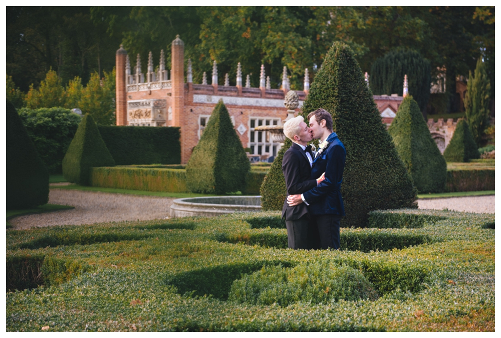 Boys kissing in ornamental maze