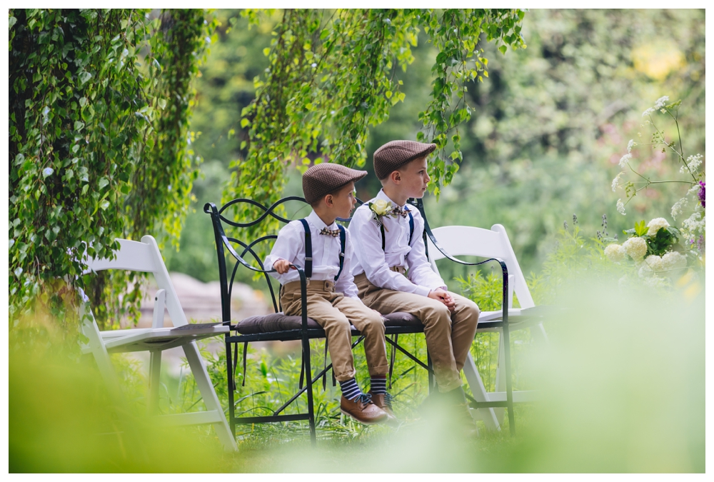 Two Pageboys sitting on Bench