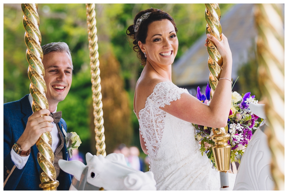 Bride and Groom on Vintage Carousel