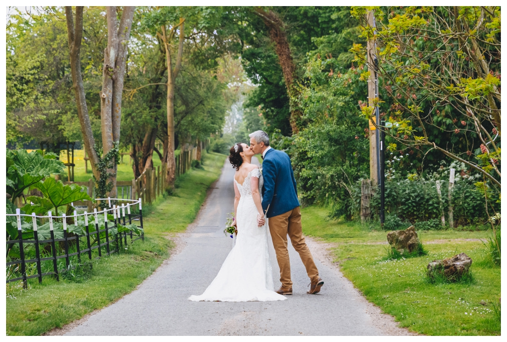 Bride and Groom Walking Down Driveway