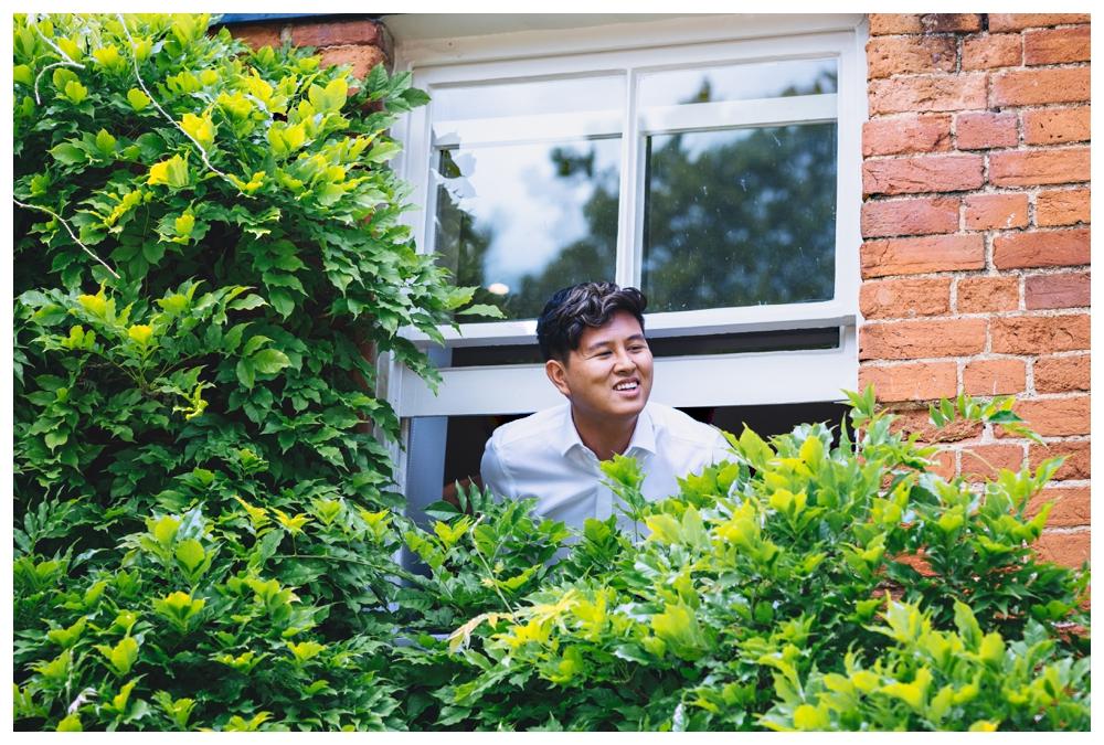 Groom Looking Out Of Window Pre Wedding