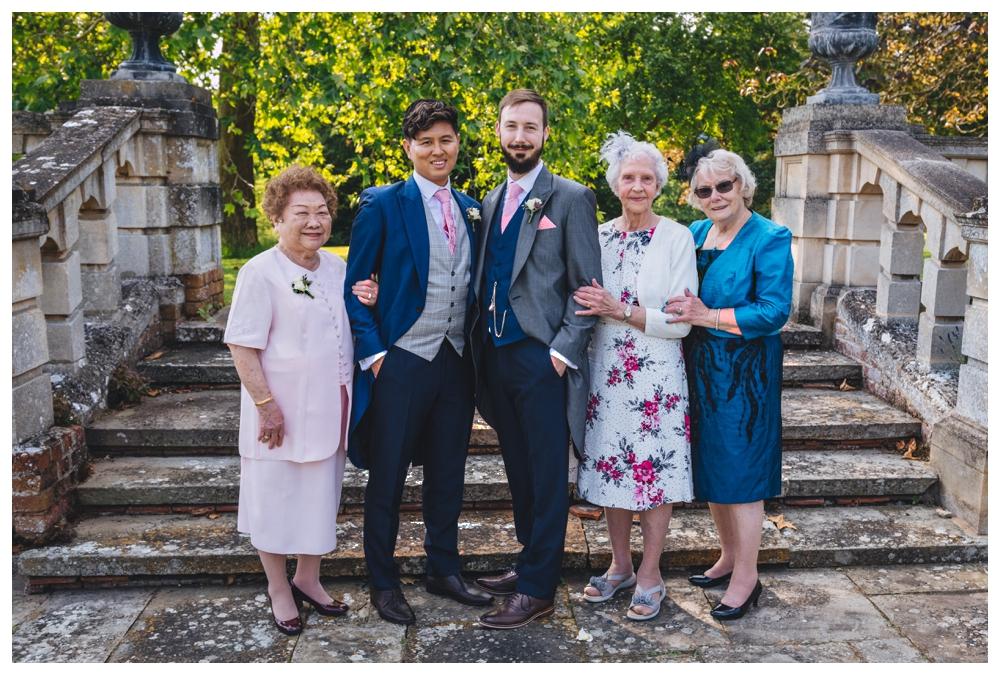 Grandparents Group Shot In Rose Garden Longstowe