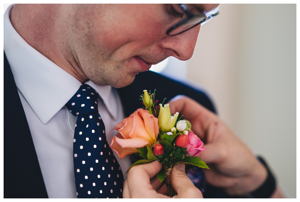 Groom Fixing Buttonhole