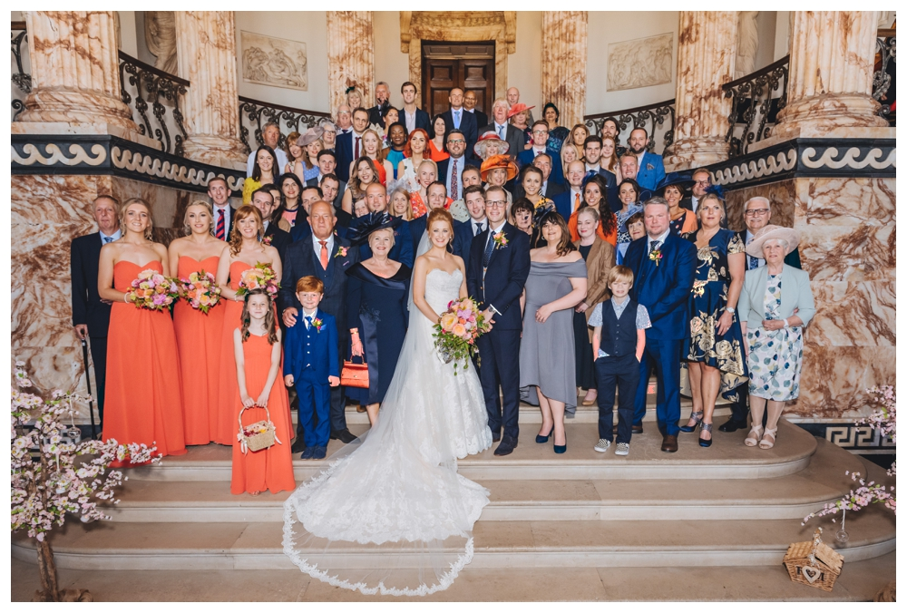 Group Shot On Staircase Inside The Marble Hall Holkham
