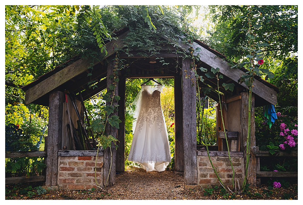 Brides Dress hanging in garden