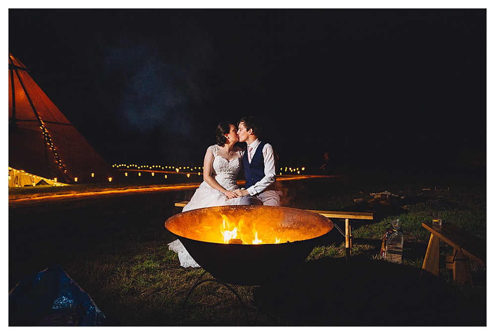 Bride and Groom In Front of Pit Fire Evening Shot